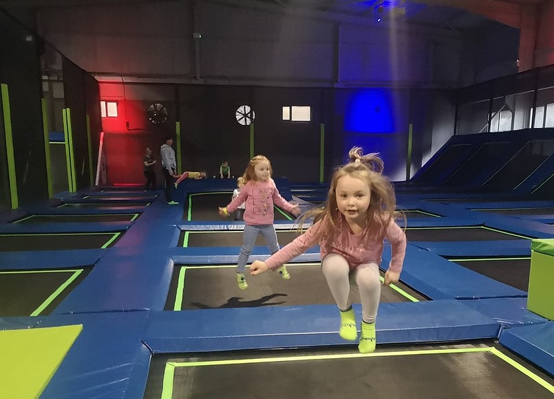 Two little girls bouncing at Jump In Enfield.