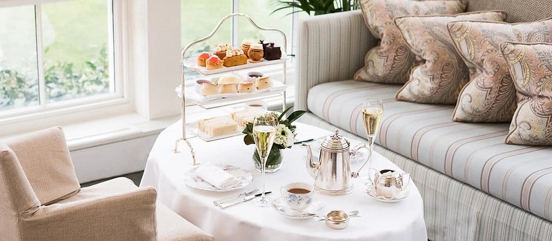 Elegant afternoon tea with fancy decor and place settings.