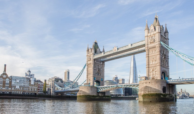 A panoramic view of Tower Bridge with The Shard in the background.