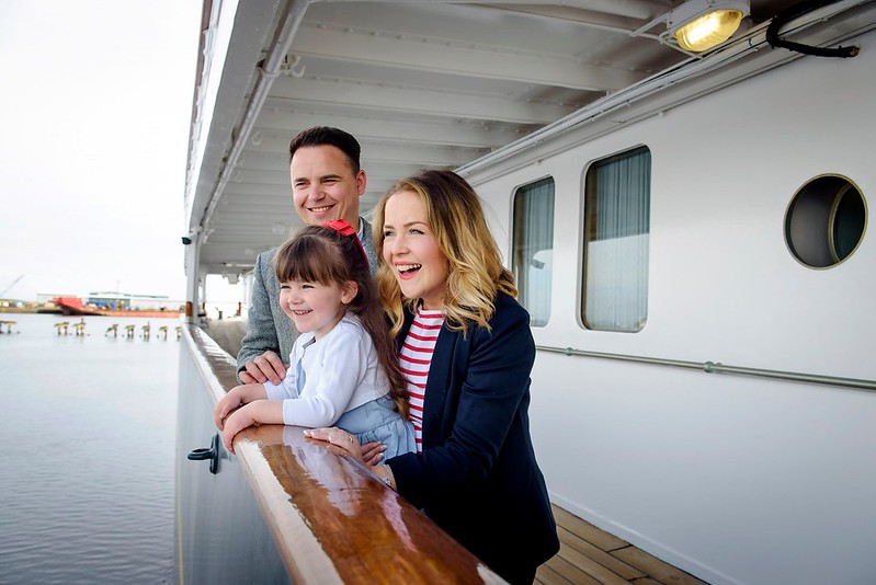 A family enjoying the view from the Royal Yacht Britannia.