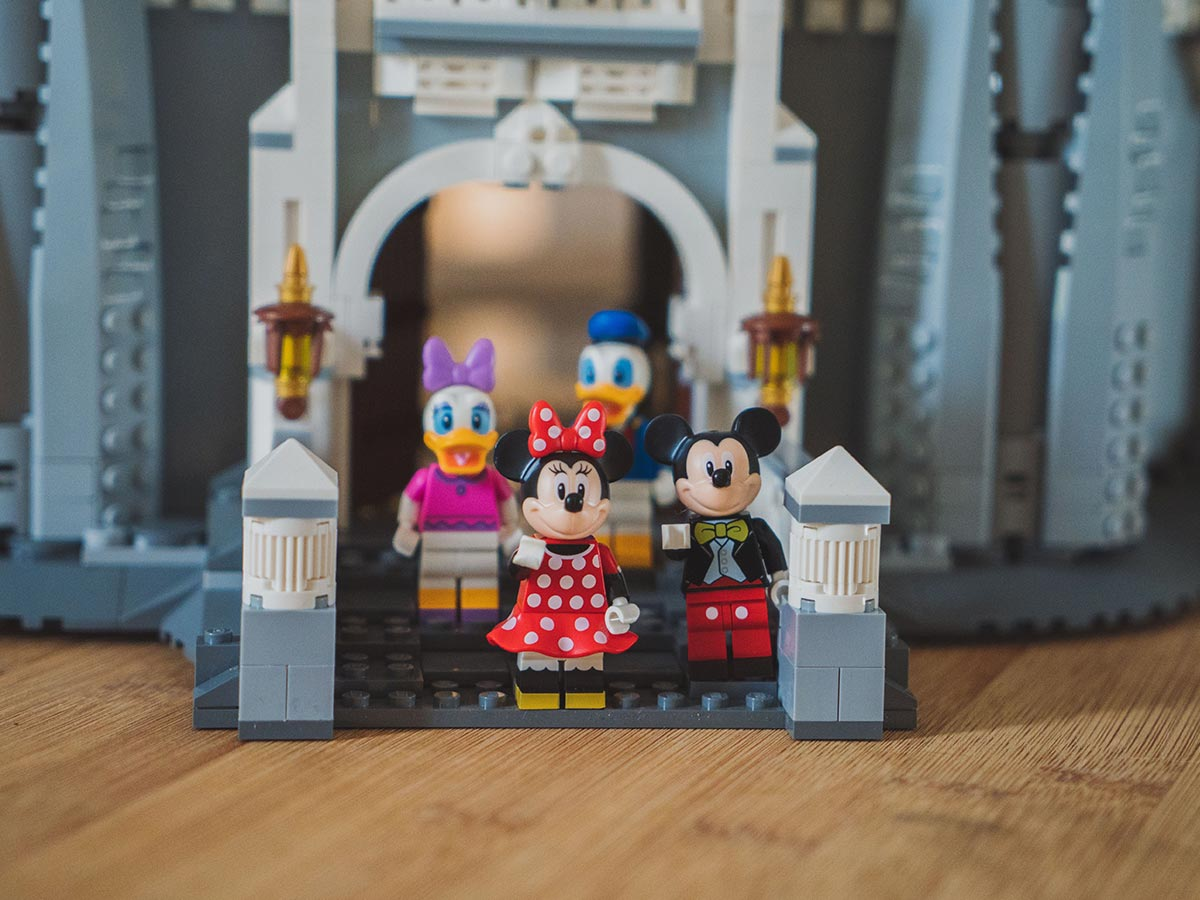 Lego figures of Disney characters Mickey and Minnie Mouse, and Donald and Daisy Duck.