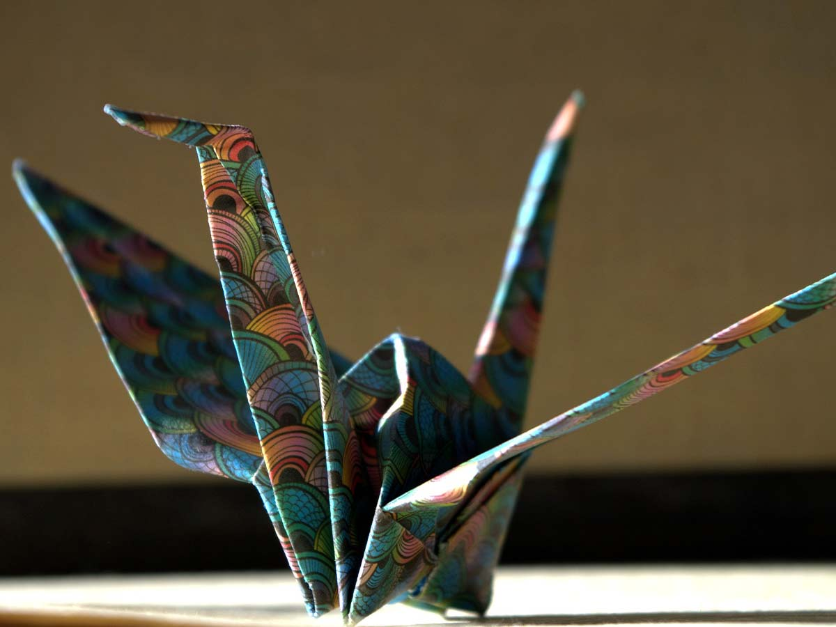 Origami swan made with a colourful, patterned paper.