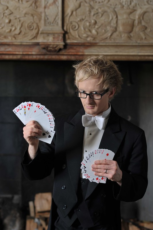 'Sonic' Tony Middleton performing a card magic trick at Le Meridien's private show.