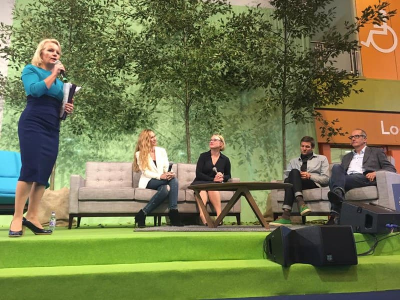 Panelists at the Grand Designs Live exhibition sitting on the stage discussing design topics.