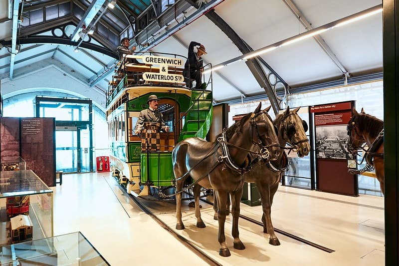 A vintage horse-drawn bus at the British Transport Museum.