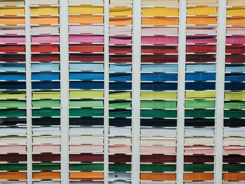 Shelves of coloured card in different sizes.