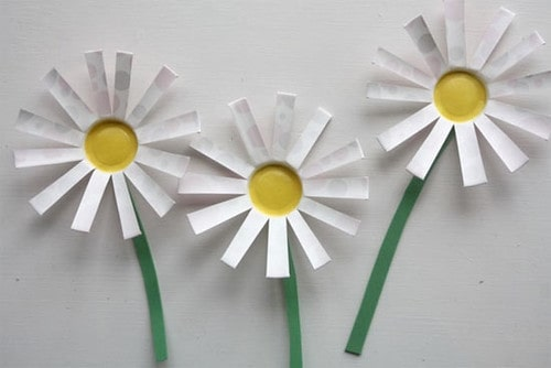 Three origami daisies.