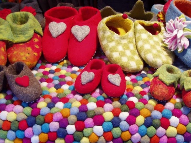 Pairs of felt shoes with decorations.