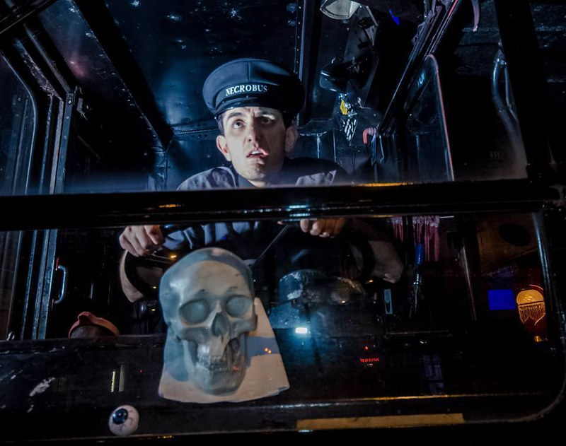 An actor conductor at the wheel of the Ghost Bus Tour Edinburgh looking scared.