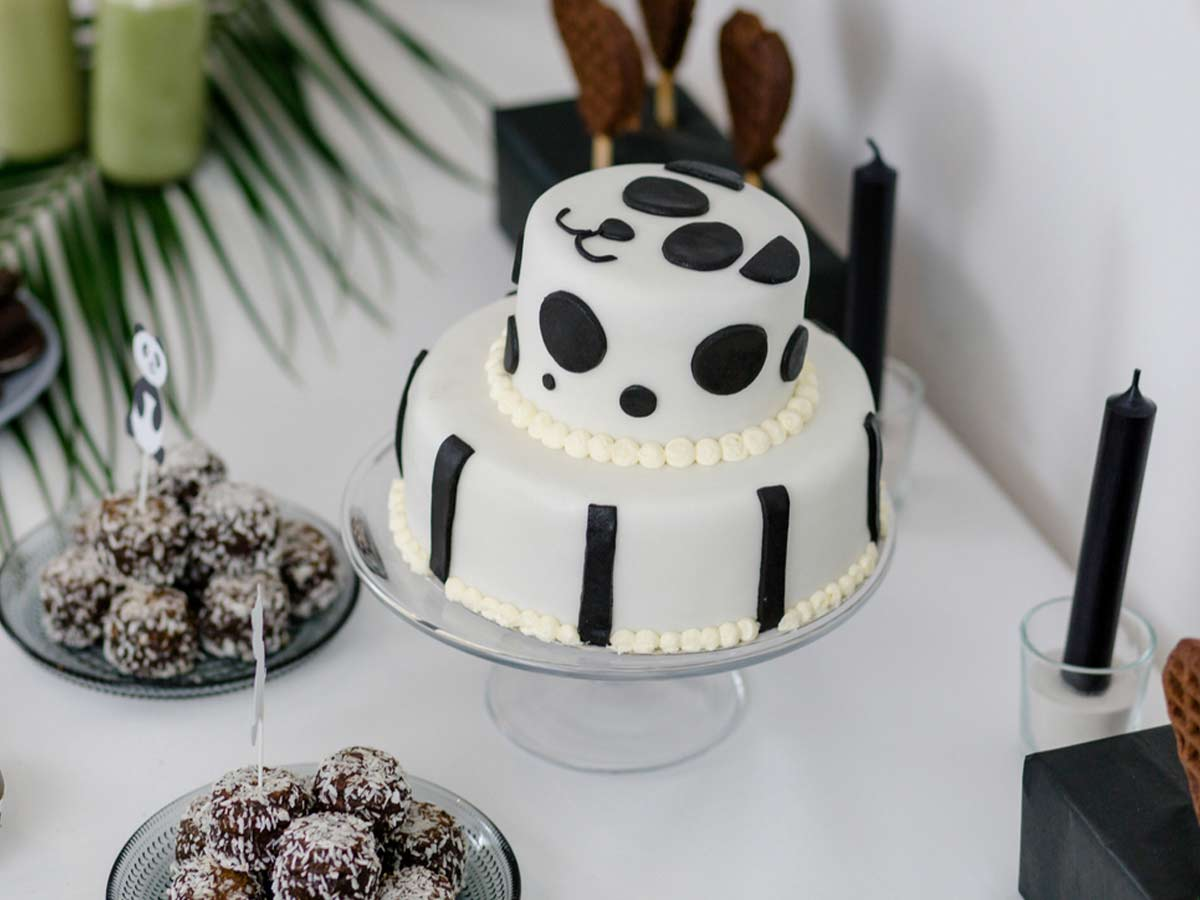 Black and white tiered cake, decorated with a panda face.