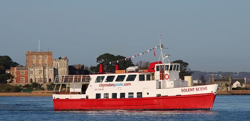 A boat from City Cruises Poole at sea along the Dorset coast.
