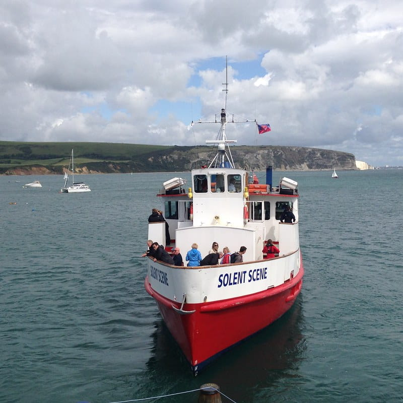 A red City Cruises Poole boat at sea in Dorset.