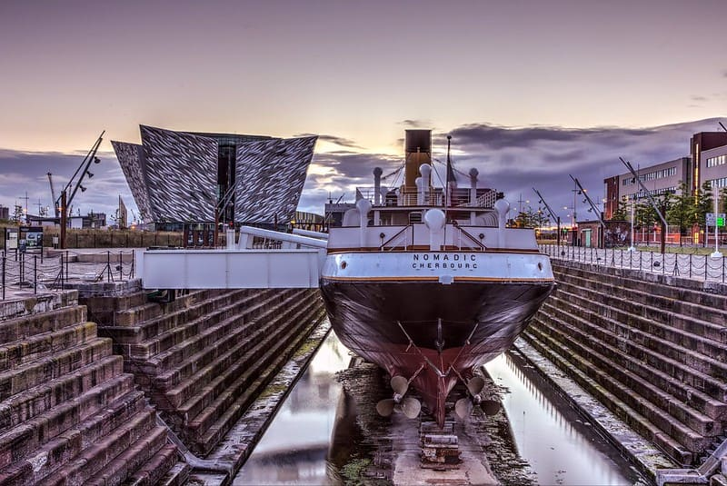 The SS Nomadic vessel berthed next to Titanic Belfast in the historic Hamilton Dry Dock.