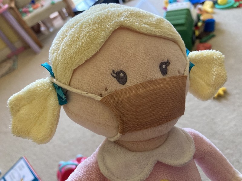 Esther toy wearing a homemade face mask.
