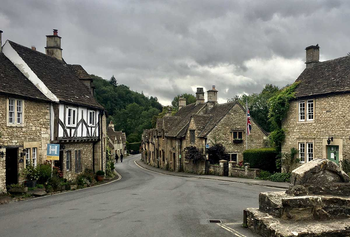 Houses in a Tudor village on a grey, cloudy day.