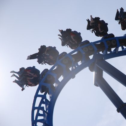 People upside down on roller coaster ride.