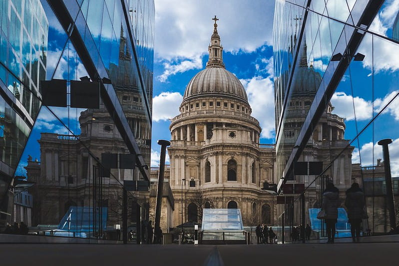 St. Paul's Cathedral between tall glass buildings in London.