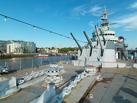HMS Belfast moored on a sunny day.