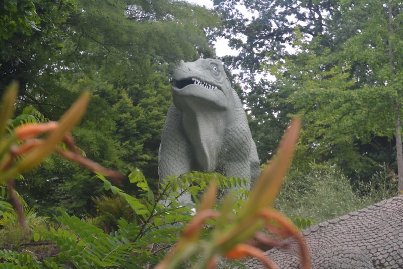 Model dinosaur in trees.