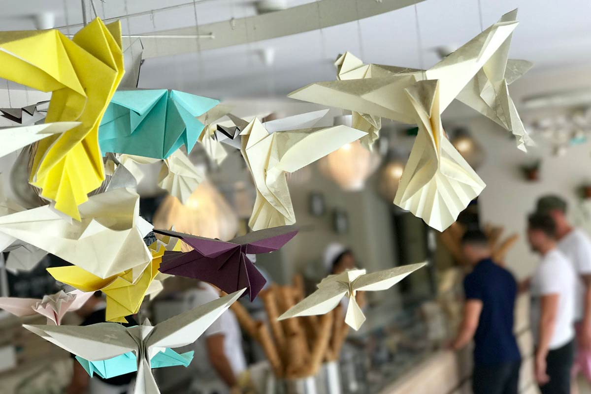 Some origami swallows hanging from the ceiling.