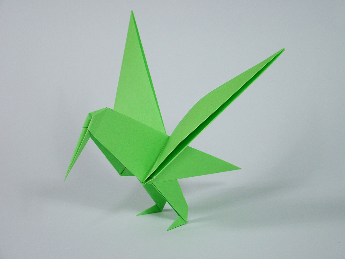 A bright green origami hummingbird.