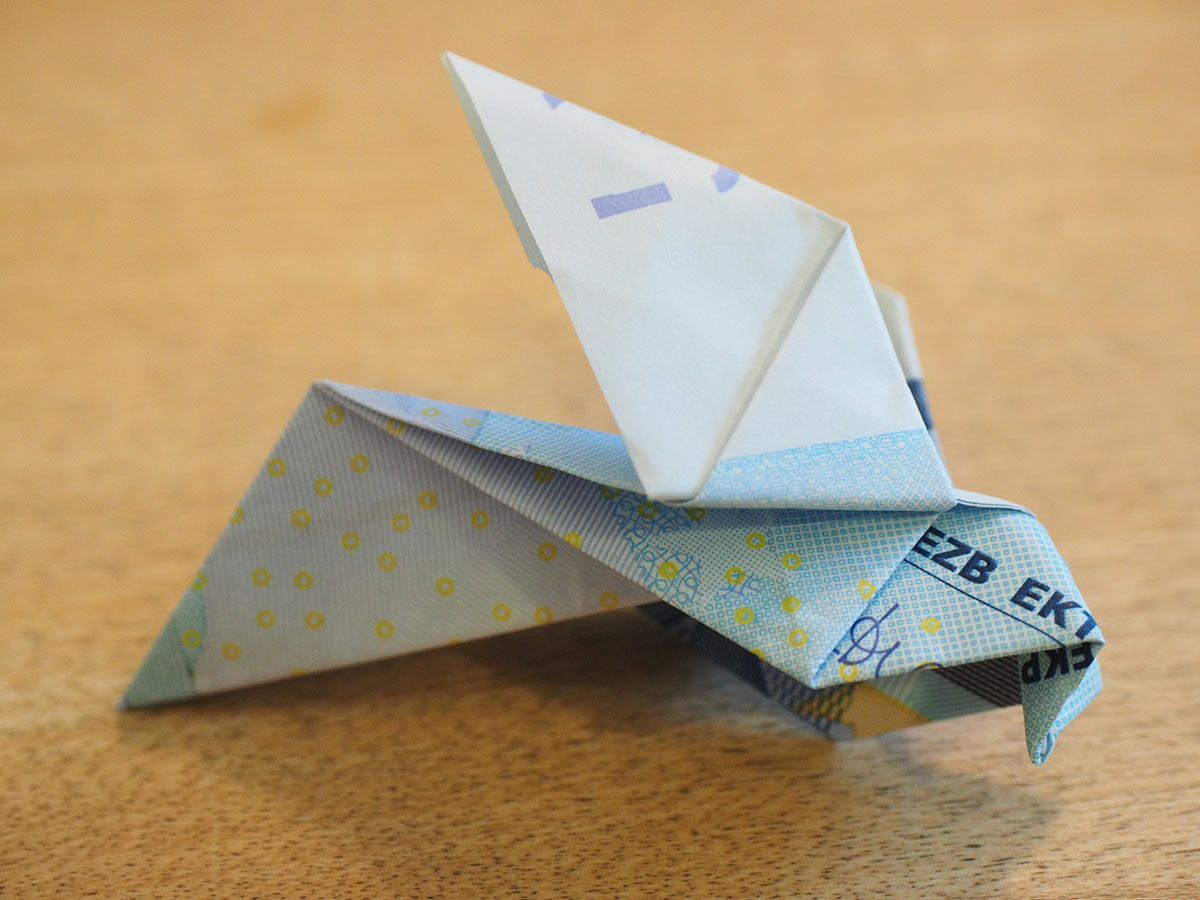 An origami hummingbird made from printed paper.