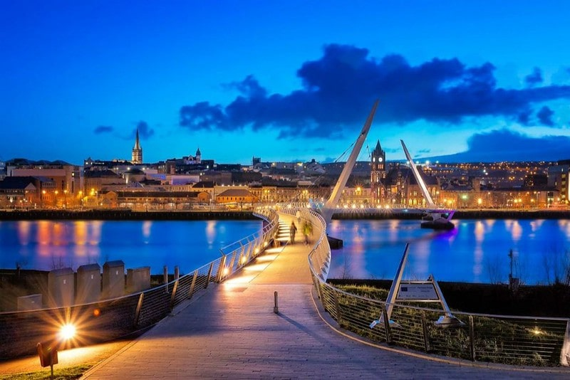 View across a bridge in Derry city centre after sunset.