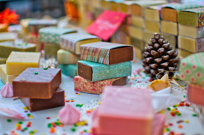 Lots of colourful bars of organic soap for kids, wrapped in patterned paper.