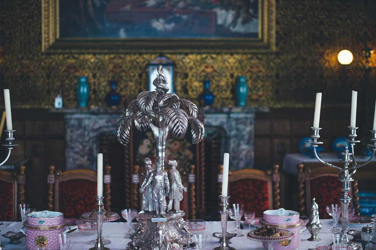 Elaborate table settings on a rich Victorian's dining table.