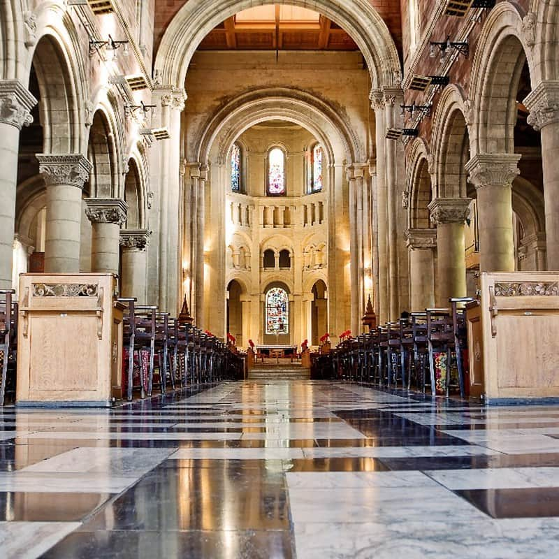 Interior of the Belfast Cathedral with grand arches and marble floors.