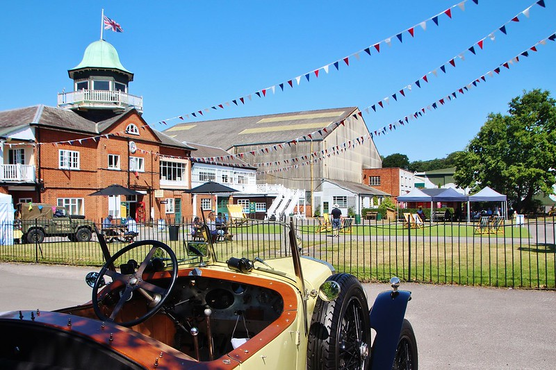 Bunting and old fashioned car at Brooklands Museum.