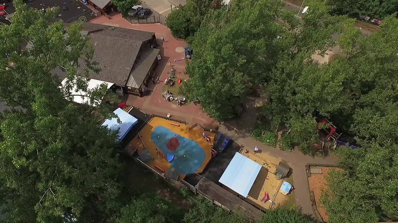 Aerial view of Thames Valley Adventure Playground, with play area and trees in sight.