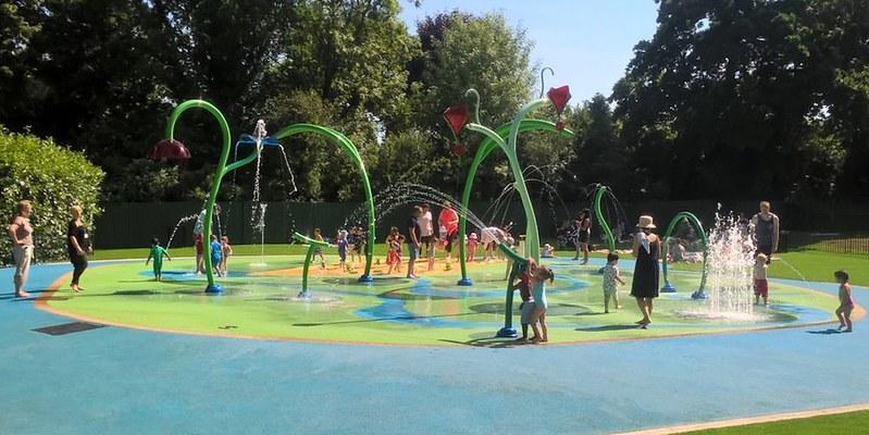 Children having fun in colourful waterpark area.