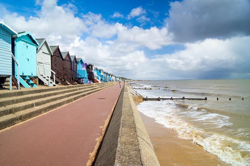 Colourful Beachhuts on sea front at Frinton Beach.