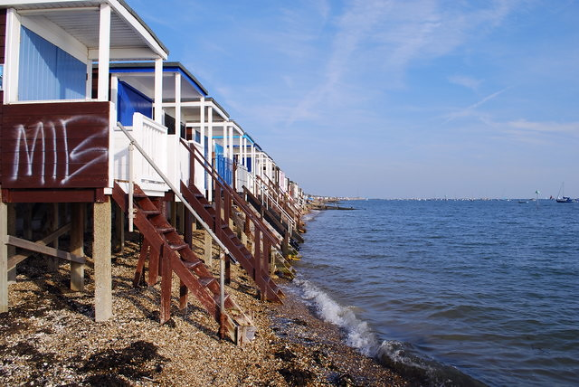 Beach huts with stairs leading into the sea.