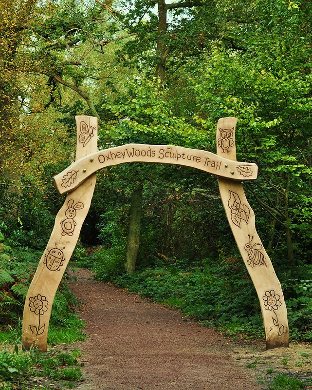 Wooden entrance sculpture to nature trail.