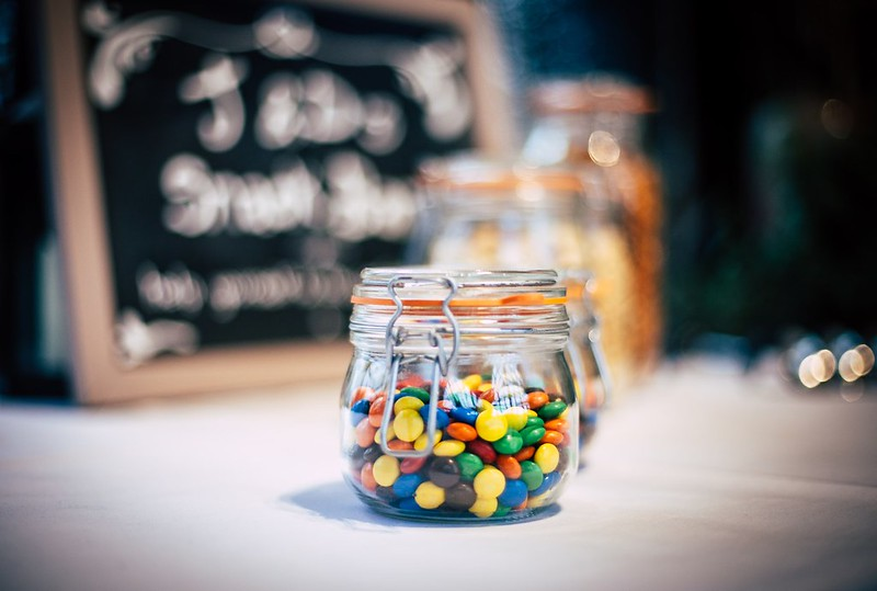 A jar of multicoloured Smarties which can be used to decorate a My Little Pony cake.
