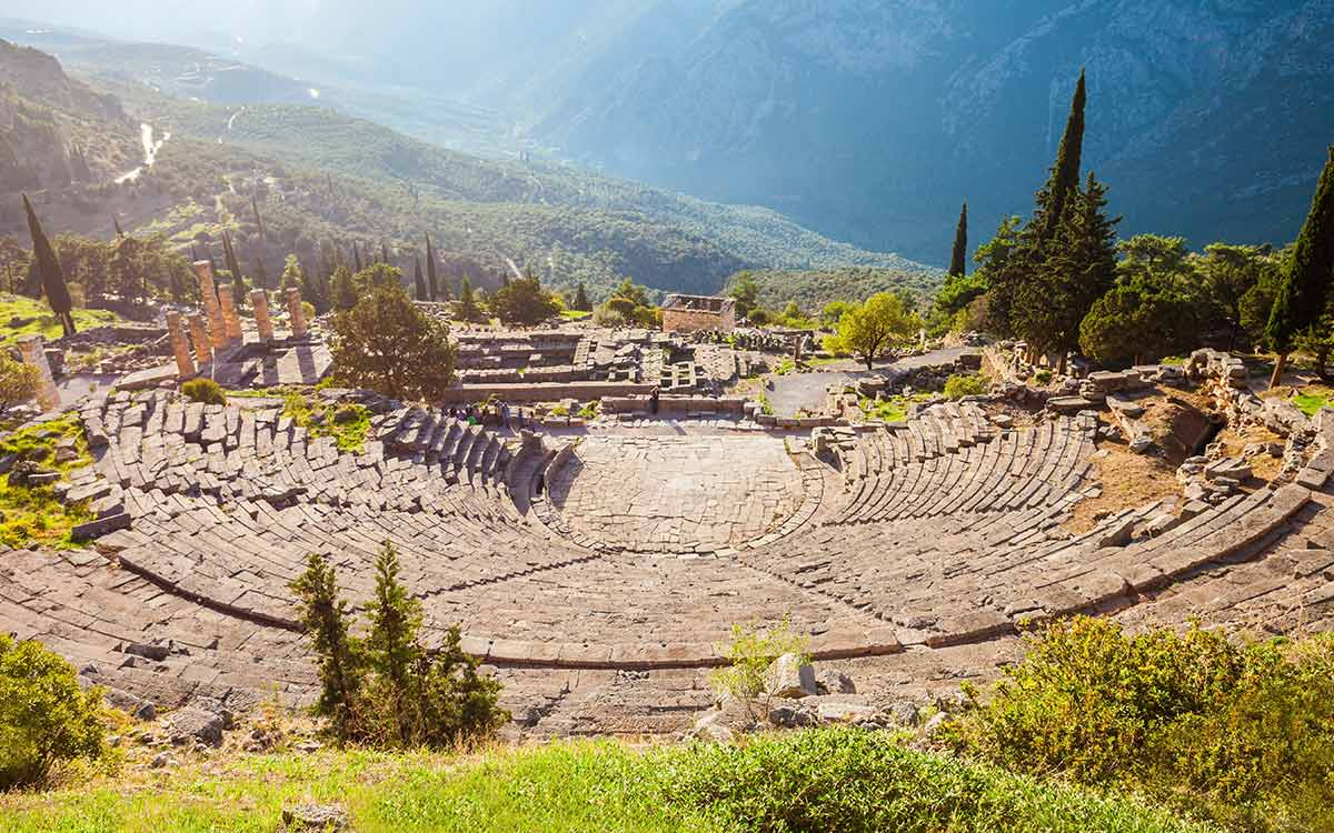 The ruins of an Ancient Greek theatre set in the mountains.