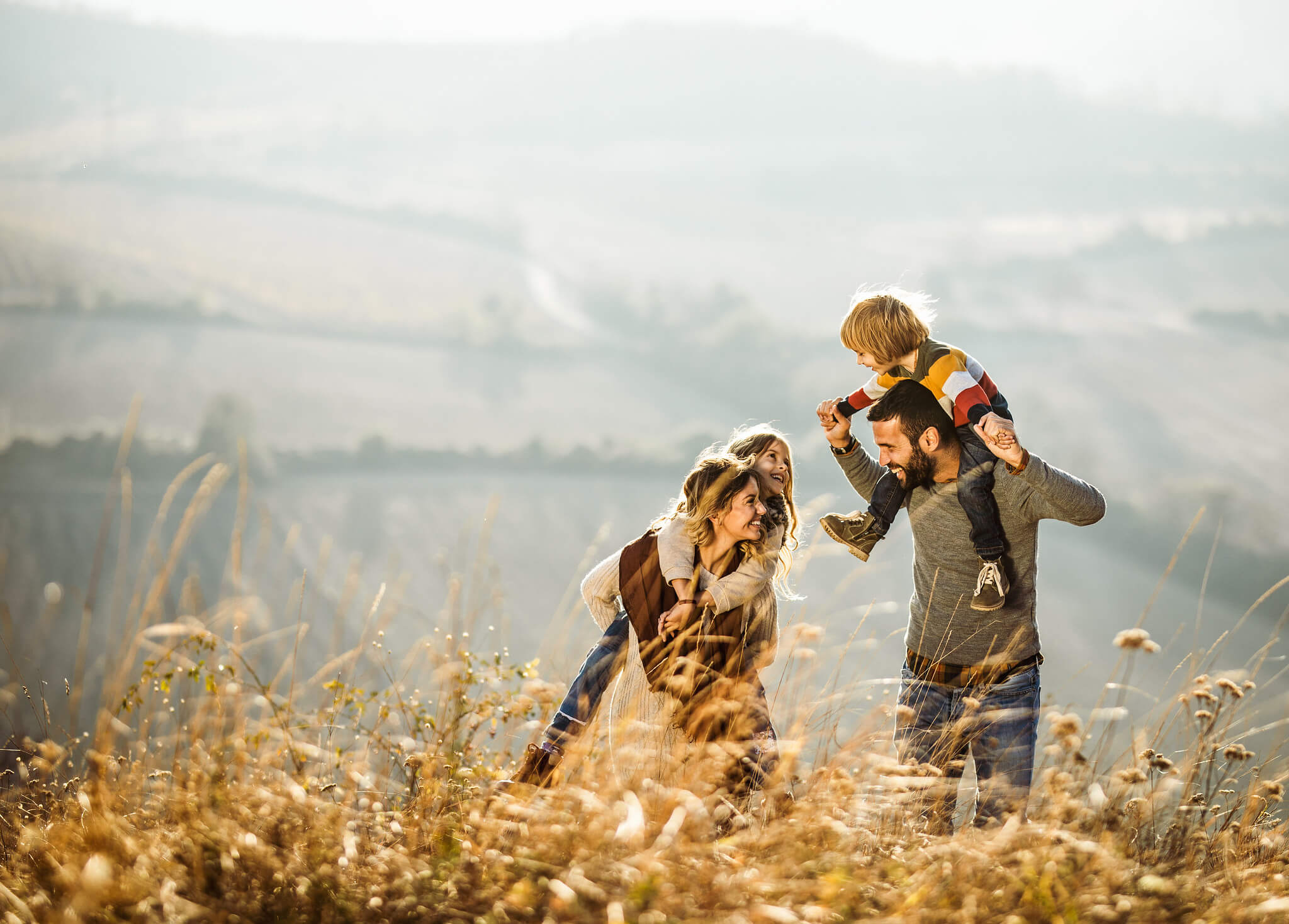 Family walking in the countryside on a hill