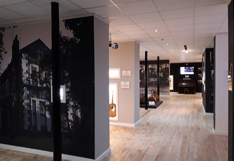 A black and white exhibition room at the Liverpool Beatles Museum.