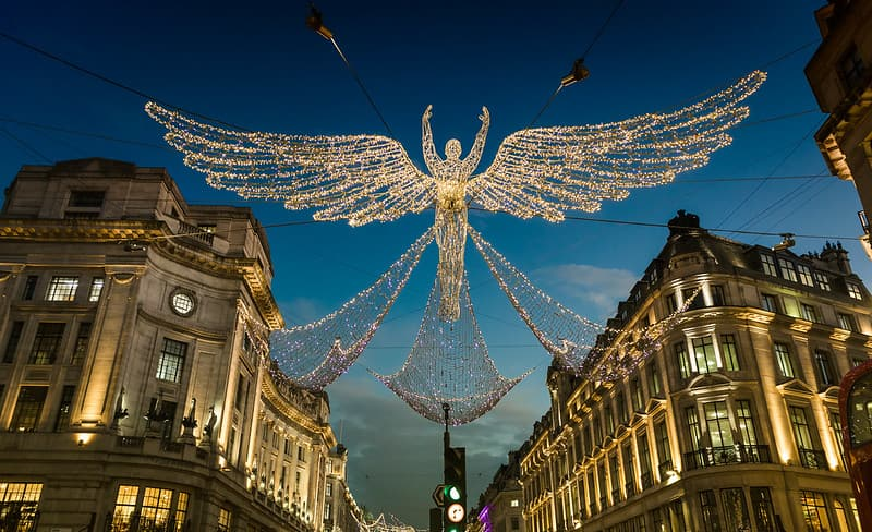Christmas lights angel hanging on Regents Street, London.