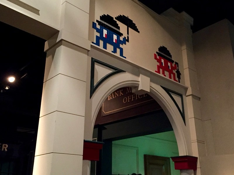 Two space invaders guarding a doorway.