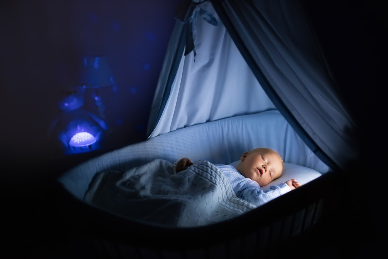 Baby sleeping crib night light on
