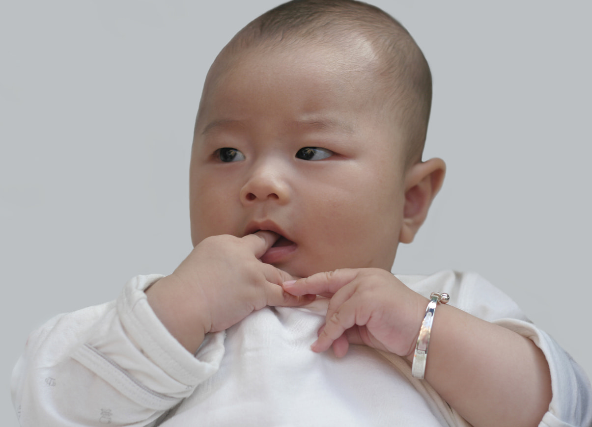 Baby wearing silver baby bracelet