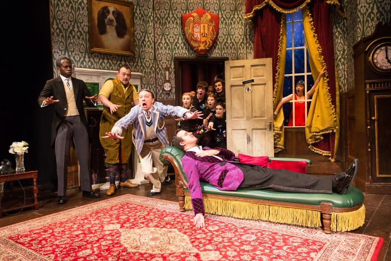 The cast of The Play That Goes Wrong in a farcical stunt on stage.
