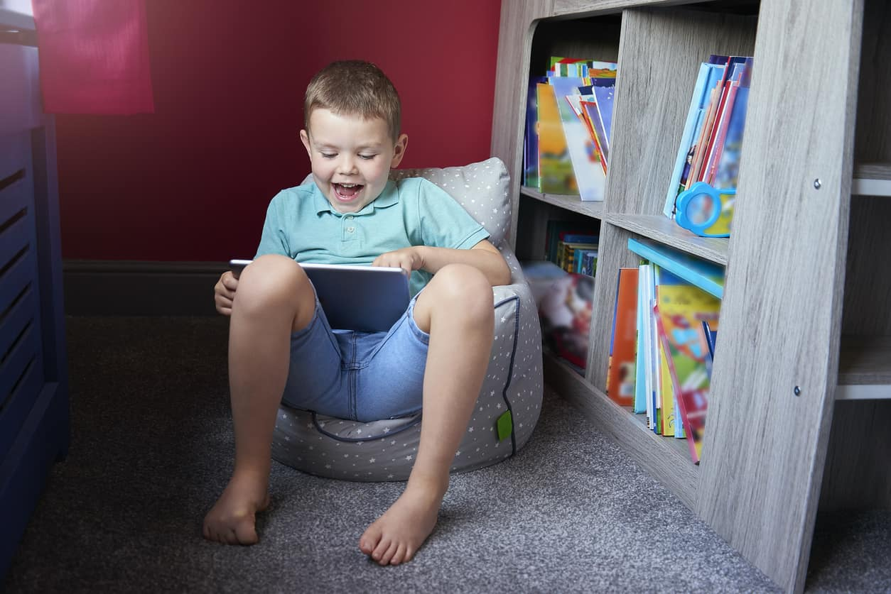 Boy reading a book from a bookcase perfect for any space