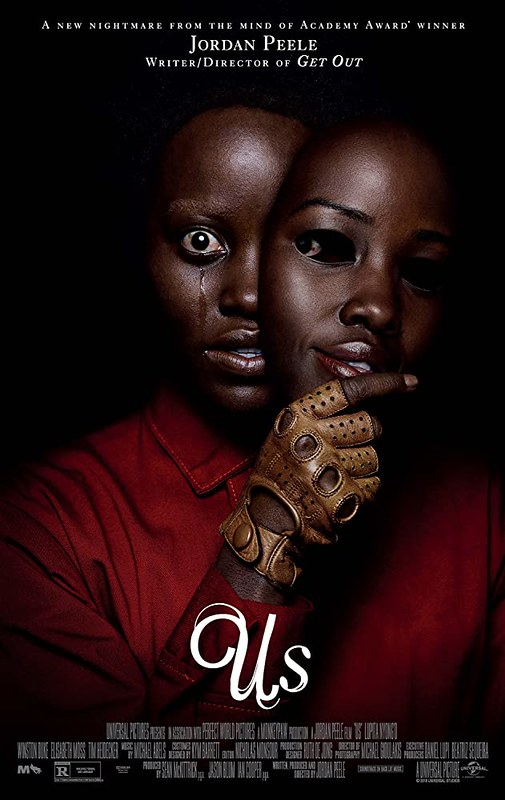 Film poster for Us with a scared Lupita Nyong'o removing a human-like mask from her face.