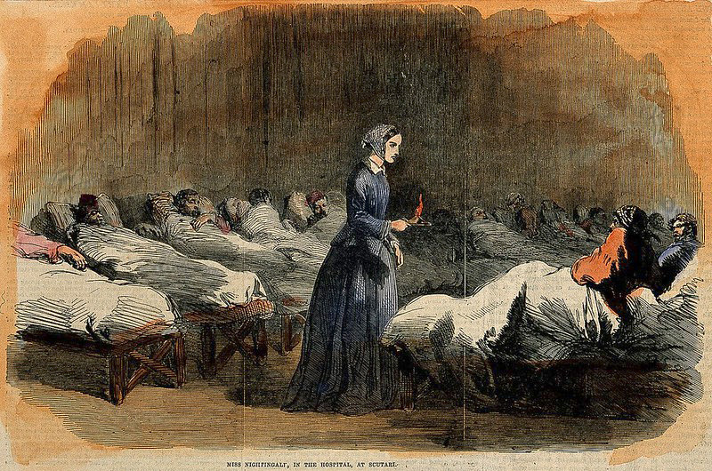 Victorian illustration of Florence Nightingale tending to patients in Crimea hospital.