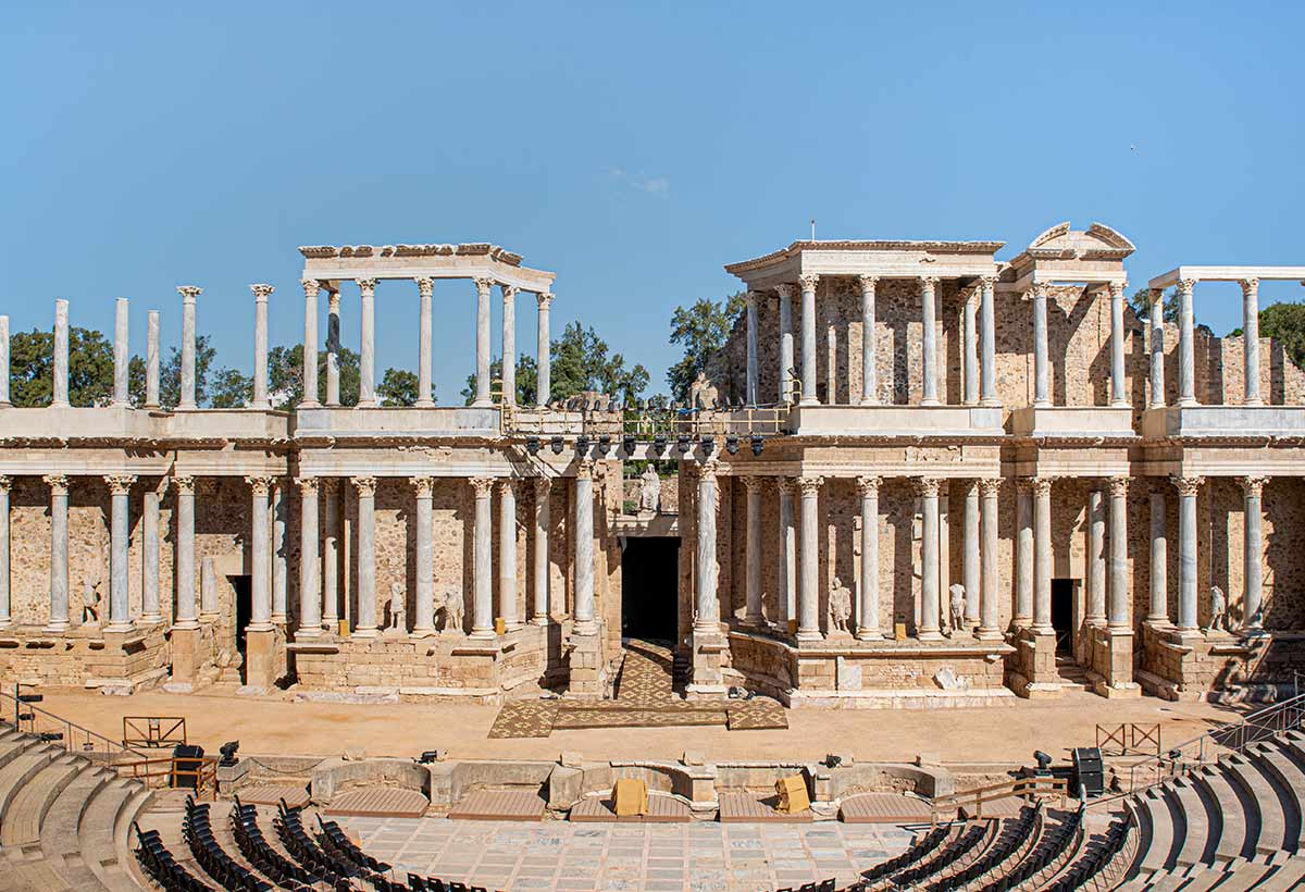Roman ruins of a theatre in typical Roman architecture with many columns.