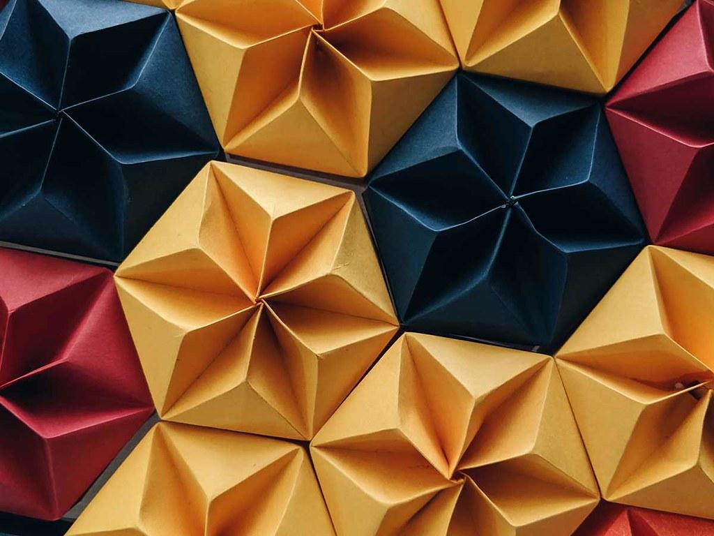 A hexagonal origami paper pattern.